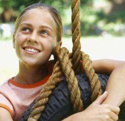 24766-summer-tire-swing-girl-smile-outside-fun-park-wide.1200w.tn